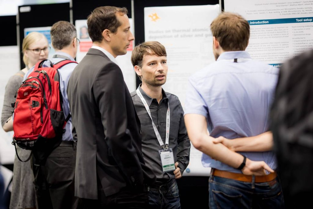 Poster session at ALD 2016, Martin Kanut (left) and Christoph Hossbach (right) presenting the poster on the Fast Screening ALD system at IHM, TU Dresden. (Photo Katharina Knaut)